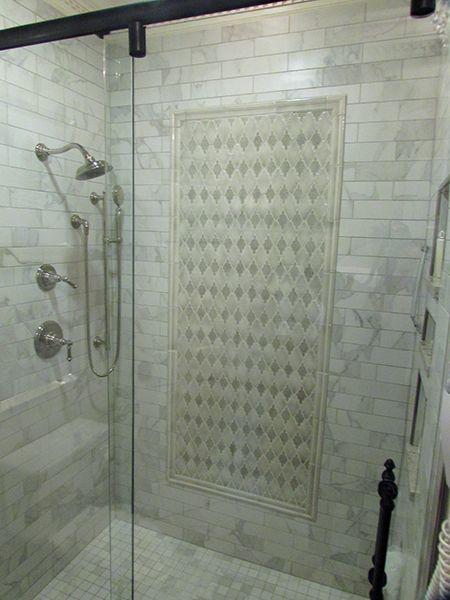 Tiled Shower W Accent Frame Featuring Encore Ceramics Arabesque Mosaic Tile And Installation By Exact Tile I Bathroom Renovations Guest Bathrooms Shower Tile