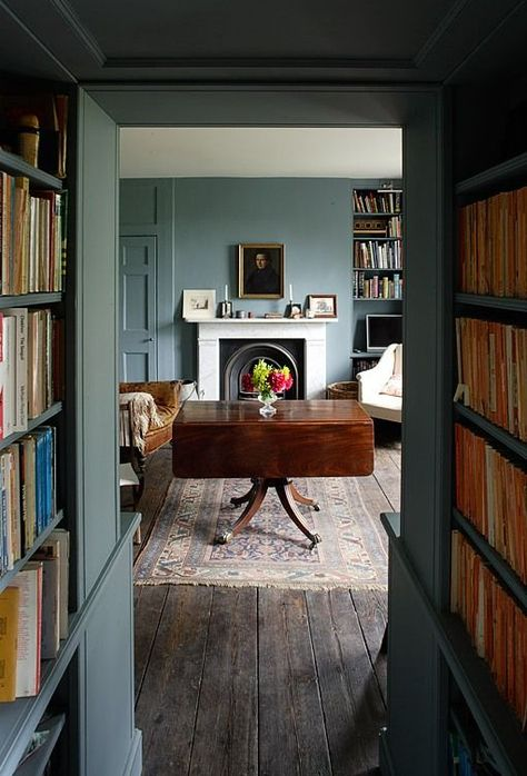 bookshelves in the hallway, color walls, white ceiling