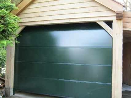 Hormann L Ribbed Sectional In Moss Green By Abi Garage Doors 1000 In 2020 Garage Doors Sectional Garage Doors Garage Door Makeover