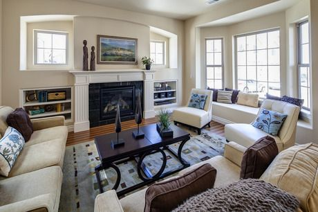 Recessed windows and shelves flank the fireplace. A bay window adds  seating and light to the Madison Townhome by Century Communities in Lone Tree, Colorado.