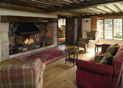 The Lounge With Woodburning Stove Set In Original Inglenook Old Bread Oven