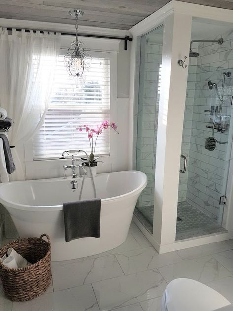 Freestanding Tub and Shower in farmhouse bathroom. ideas and inspo for remodeling
