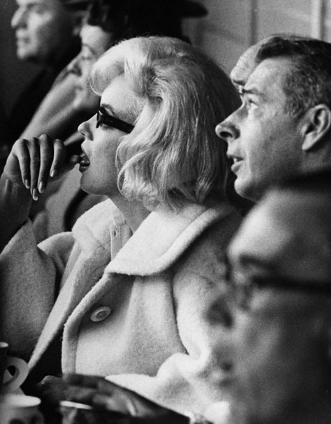 Marilyn and Joe DiMaggio attend the opening game of the baseball season, between New York Yankees and Minnesota Twins at Yankee Stadium, New York, 1961.