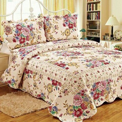 Showcasing A Blooming Floral Motif This Reversible Cotton Quilt