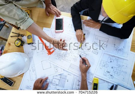 Engineer People Meeting Working And Pointing At A Drawings In Office For Discussing Engineering Tools And C Roofing Contractors General Contractor Contractors