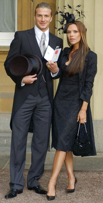 David Beckham In 2003 With Victoria Beckham Was Awarded Obe By The Queen For His David And Victoria Beckham Victoria And David David Beckham Style