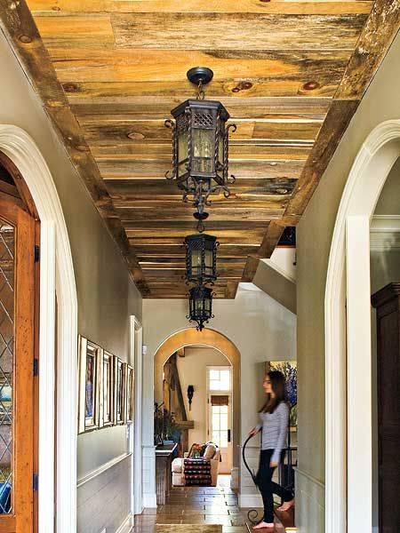 MyHomeIdeas.com - Outdoor Ornaments from Southern Living: Pay close attention to the ceiling when walking though this hallway. Salvaged wood (also found on the family room fireplace) is used as wood paneling, and outdoor lanterns lead the way. (Photo: Laurey W. Glenn)