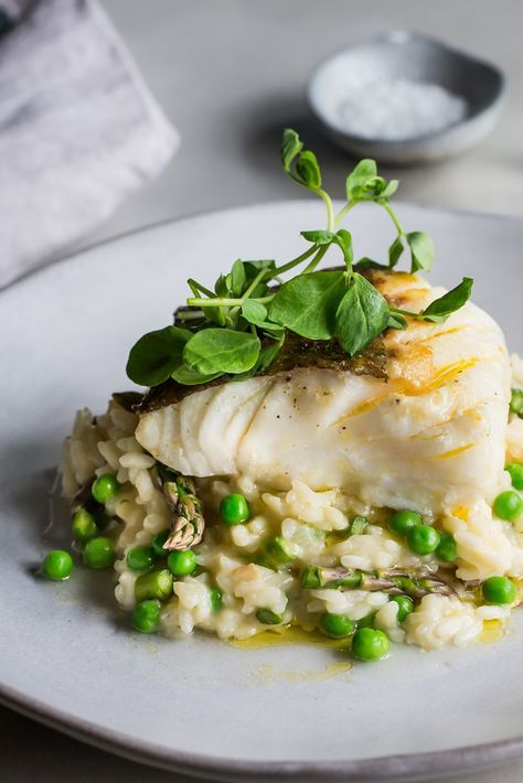 Cod with asparagus and pea risotto
