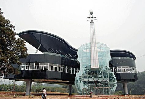 The Piano House – Huainan City, An Hui Province, China What's weirder than having a giant violin leaning against your piano-shaped building? Having a translucent giant violin leaning against your piano-shaped building. Image via Design You Trust Beautiful Places To Travel, Cool Places To Visit, Places To Go, Unusual Buildings, Amazing Buildings, Architecture Cool, Crazy Houses, Weird Houses, Dream Houses