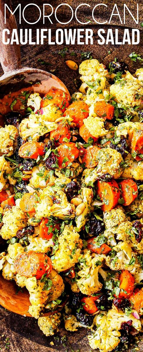 This Roasted Cauliflower Salad is a hypnotic combination of roasted veggies, pepitas and craisins bathed in an EASY vibrant, spicy Moroccan chermoula dressing!  And the best part is it is 100% make ahead friendly and stores beautifully!  #cauliflower #cauliflowersalad  #salad #saladrecipes #dinner #dinnerrecipes #dinnertime #healthyrecipes #healthyfood #healthyeating #healthysnacks #thanksgiving #thanksgivingrecipes #sidedishrecipes #side #easyrecipe #roastedvegetables #vege via @carlsbadcraving