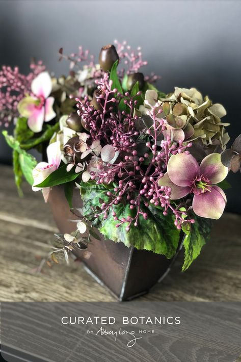 This gorgeous collection of flowers, foliage, and berries has a charming, wintery feel. The aged-look copper tin is narrow in depth so works well in a tight space or on a narrow ledge. #curatedbotanics #mothersdaypresent #fauxflowers #duskypinks #tinvase #fauxflowers