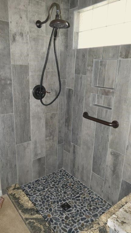 Wall Is Cellar Char 8x36 Shower Floor Is Black Pearl Flat Pebbles