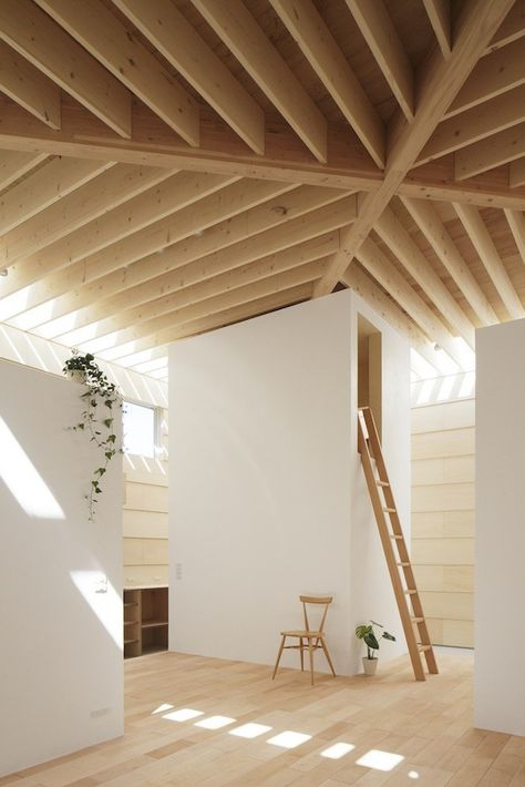 Japanese architecture studio mA-style architects designed the 'Light Walls House', a minimal home with wooden roof beams that diffuse natural sunlight in a unique way. Located in a residential area in Toyokawa, the sun-drenched interiors consist of four individual boxes that act as private spaces and can be entered via ladders