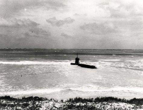 A Japanese two-man midget submarine grounded on the coral reef off Bellows Field near Waimanalo was commanded by Ensign Kazuo Sakamaki, who swam ashore on December 8, 1941 and was captured. His comrade died in action and his body washed ashore.