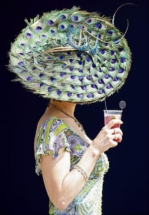 Kentucky Derby hat.  Not so giant and dramatic, but this is a cool use of peacock eyes.
