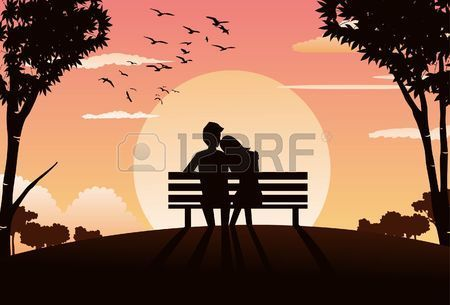 An image of a couple s silhouette sitting on a park bench during sunset and the woman s head is rest Stock Photo