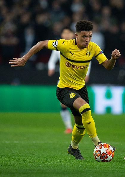 Jadon Sancho Of Borussia Dortmund Controls The Ball During The Uefa