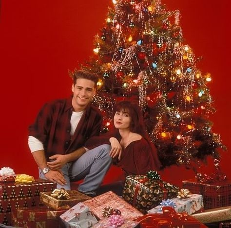 Brenda and Brandon were just kids…who acted like a married couple when given a Christmas tree and some presents. | 18 Extremely Awkward Celebrity Christmas Photoshoots