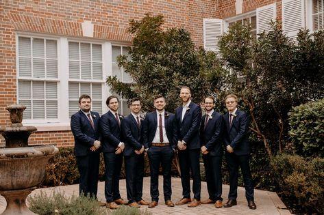 Classy groomsmen and groom in dark navy suits with burgundy ties. #weddingparty #weddingplanning #weddingcolors