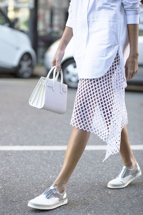 Offset crisp white shirts and accessories with metallic details and a fabulous skirt