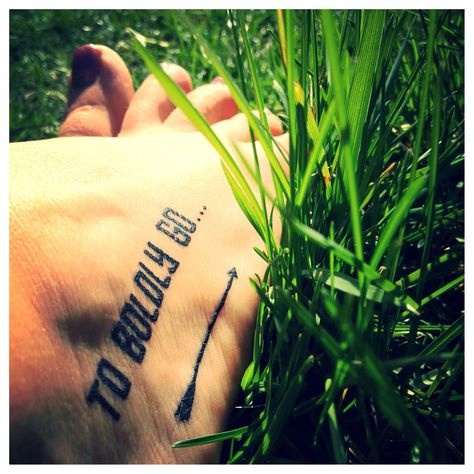 """To boldly go where no man has gone before. Star Trek The Original Series tattoo.  I love that it's on her foot.  I also like the idea of """"Energize"""", as in the transporter keyword."""