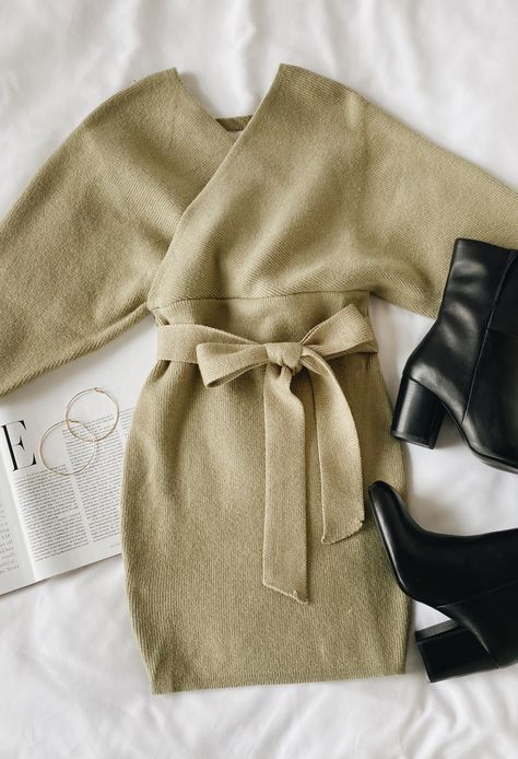 Say hello to fall in a new sweater dress! Lulus Modena Sage Green Dolman Sleeve Bodycon Sweater Dress is the perfect staple for the season. Style with black boots and gold hoops for a cute fall outfit. #lovelulus