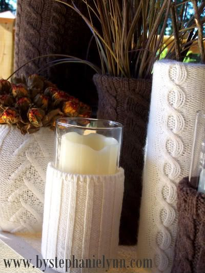 Use old sweater sleeves over cheap vases for winter decor!