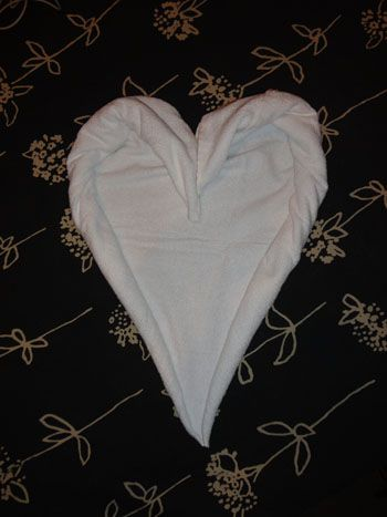 Just in time for Valentine's Day. Learn how to make this towel origami heart online at http://FoldingMagic.com .