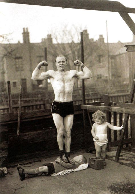 Champion steel-bender George Challard trains his four year old son in the art of strongmanship by standing on his chest to toughen him up - UK - 27 March 1936