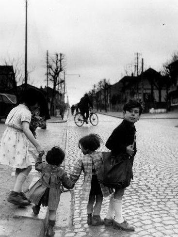 Robert Doisneau  //  Children in Paris Suburbs, Villejuif, 1950s. (   http://www.gettyimages.co.uk/detail/news-photo/children-holding-hands-in-a-street-of-villejuif-news-photo/121516409