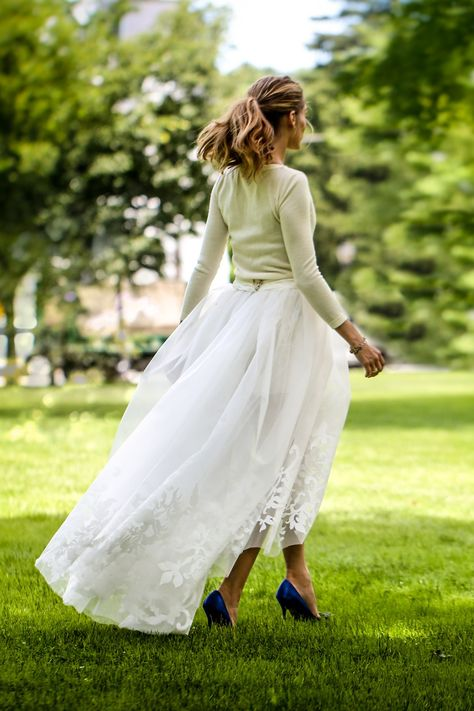 Another look at Olivia Palermo's wedding outfit: cashmere sweater & tulle skirt (worn over demure white shorts) by Carolina Herrera and cobalt Manolo Blahnik heels. PERFECTION!