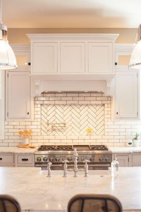 Glazed brick backsplash with herringbone pattern pot filler niche - by Rafterhouse.