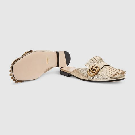 62fdde200 Shop the Marmont metallic laminate leather slipper by Gucci. The Marmont  slipper with the Double G hardware on fold over fringe.