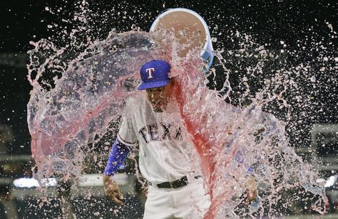Texas Rangers' Carlos Gomez is doused with a drink cooler by Elvis Andrus after a baseball game against the Cleveland Indians in Arlington, Texas, Thursday, Aug. 25, 2016. The Rangers won 9-0. (AP Photo/LM Otero)