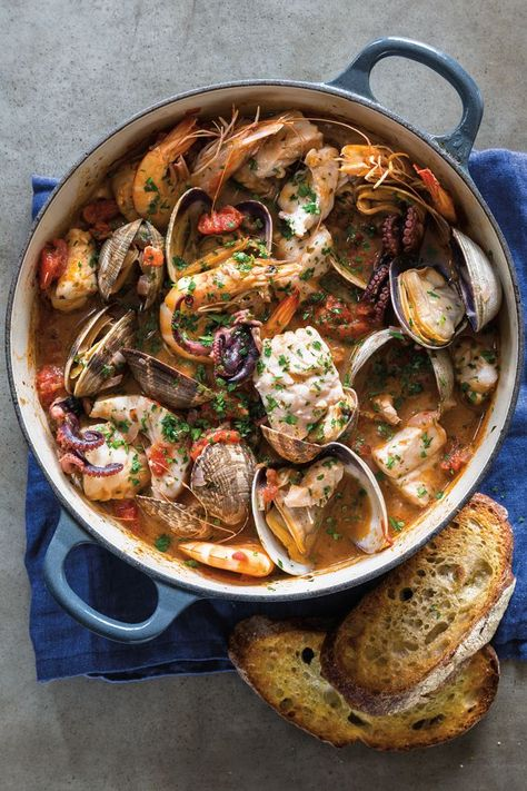 Almost every coastal town in Italy has its own version of seafood stew, typically made with whatever is left over at the fish market that day. We like to serve Livorno fish stew recipe with the traditional accompaniments of bruschetta and a green salad. Italian Seafood Stew, Seafood Soup, Seafood Dishes, Seafood Recipes, Cooking Recipes, Healthy Recipes, Cooking Fish, Skillet Recipes, Cooking Tools