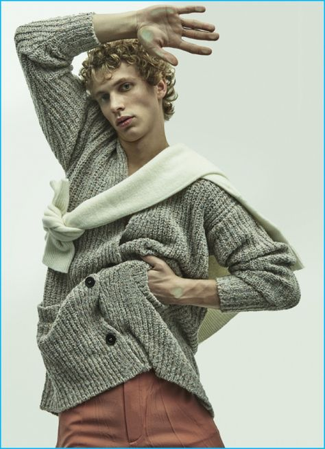 Robbi wears wool crewneck sweater tied around neck Christophe Lemaire and trousers Gucci.