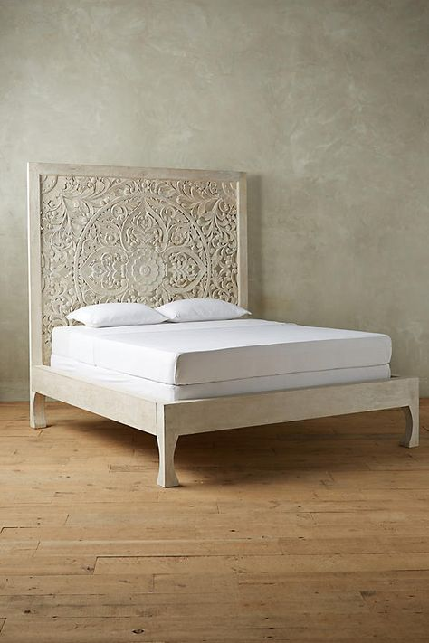 Handcarved from solid mango wood, this elegant bed frame is a true work of art. Its filigree-inspired cutouts create a lively shadow play when placed near a...