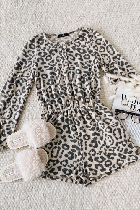 Fall in love with Lulus Wanna Cuddle? Beige Leopard Print Long Sleeve Lounge Romper! Super soft brushed hacci knit, with a black leopard print, shapes this lounge romper that has a rounded neckline, henley-inspired bodice with button closures, and long sleeves with elastic cuffs. A stretchy elastic waist tops loose-fit shorts with hidden side seam pockets. #lovelulus