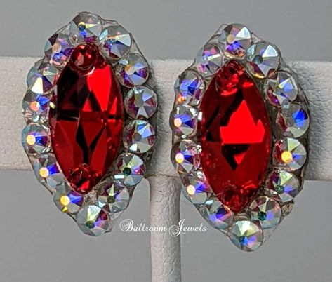 Created with a Light Siam center navette shaped Crystallized™Swarovski Elements crystal Limited stock! Swarovski doesn't make the center crystal any more, once our inventory is gone, this earring will be discontinued. These earrings are 1 long and ¾ inches wide clip designs.