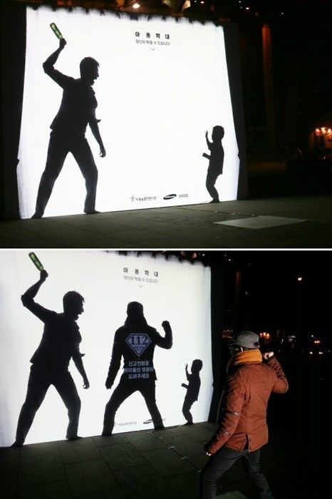 """This silhouette mural was found in South Korea. The text reads """"child abuse, you can prevent it,"""" and when someone adds their shadow to the mural: """"Report to become a hero for children. Guerrilla Advertising, Clever Advertising, Guerilla Marketing, Advertising Campaign, Advertising Design, Interactive Poster, Interactive Design, Ads Creative, Creative Posters"""