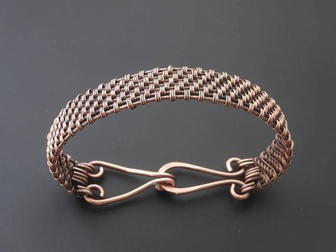 Hand woven sturdy copper bracelet with a hammered clasp. The weave used adds a lovely texture to the bracelet and adds lots of depth when oxidised, made to order to the length of your choice. A patina was added to add depth and bring out the detail in the weaving and then it was