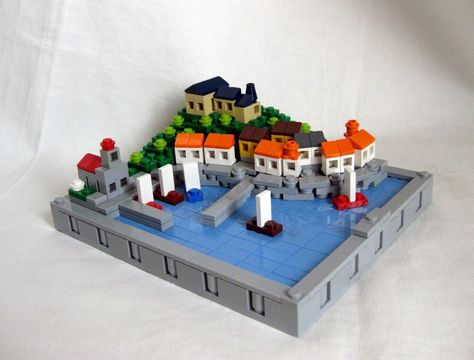 Lego Village Very clever way of making a curved shoreline in lego, and the boats are so simple its genius..!
