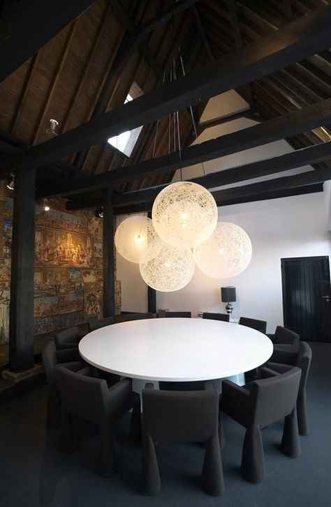 Lute Suites in Amsterdam, designed by Marcel Wanders have gabled roofs with exposed joists, an industrial-chic aesthetic, patterned screens, textured walls, and unique decor.