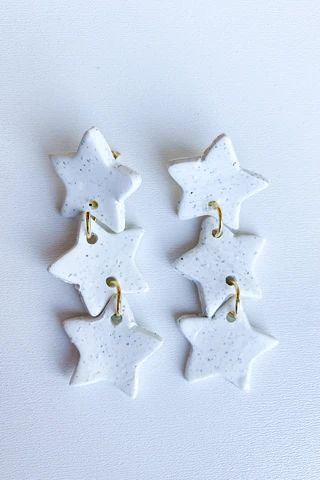 stars earring support in style! of your purchase towards these handmade clay earrings by positive statement co. Polymer Clay Ornaments, Polymer Clay Christmas, Polymer Clay Canes, Diy Clay Earrings, Polymer Clay Necklace, Star Earrings, Cute Clay, Clay Charms, Clay Creations