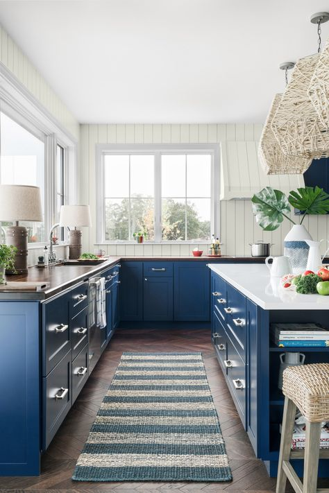 Bring boldness to your nautically styled space. ⚓️ Timeless complementary colors like Long Horizon and Bohemian Lace make the blue-and-white kitchen of HGTV Dream Home 2021 pop. 😍 Sponsored by HGTV Home® by Sherwin-Williams.