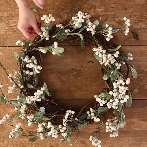 Add the finishing touch to your fall front porch with a lasting white berry wreath. We'll show you how to make your own in three simple steps. #wreath #frontdoordecor #whiteberrywreath #bhg