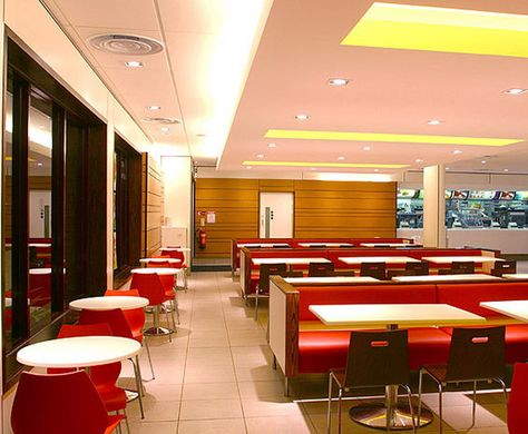 New McDonald Restaurant Redesign with Eating Experience for the Costumer: Fabulous Dining Room Space Idea With Long Red Benches And White Ta.