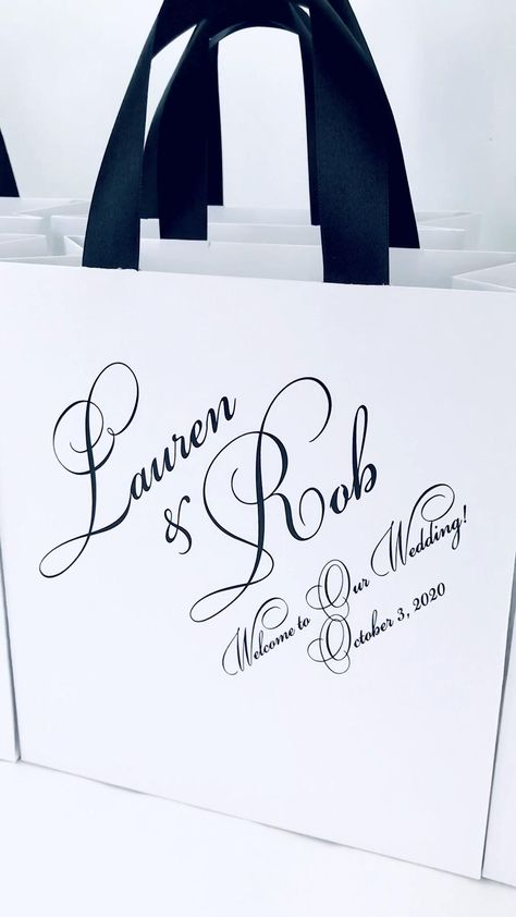 Elegant wedding welcome bags with satin ribbon handles and your names. Personalized gift bags for wedding party favors for guests. #welcomebags  #weddingwelcomebags #giftbags #personalizedgifts #weddingfavor #weddingfavors #weddingbags #weddingfavorideas #weddingparty #favorbags #weddingwelcome   #elegantwedding #ivorywedding