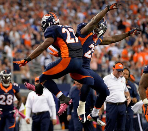 Running back Knowshon Moreno #27 of the Denver Broncos celebrates his touchdown with running back Ronnie Hillman #21 of the Denver Broncos i... #ProFootballDenverBroncos
