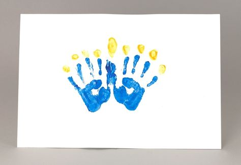 Make your own Chanukah Handprint Menorah with Crayola® Washable Finger Paint to celebrate the Festival of Lights!
